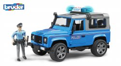 Land Rover Defender St. Wagon police vehicle with policeman and
