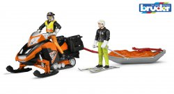 Snowmobil with driver, Akia rescue sledge and skier